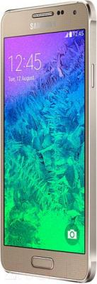 Смартфон Samsung G850F Galaxy Alpha (золотой) - вполоборота