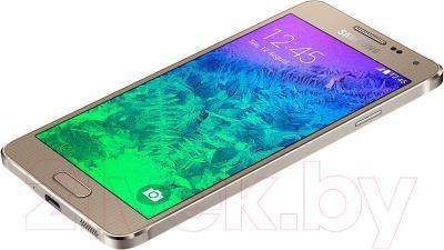 Смартфон Samsung G850F Galaxy Alpha (золотой) - вид лежа