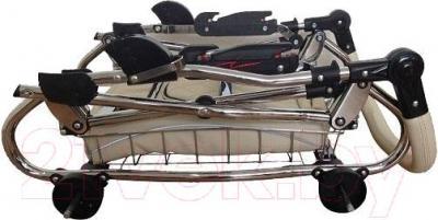Детская универсальная коляска Tako Mille (03) - в сложенном виде