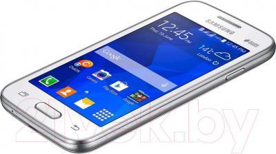 Смартфон Samsung Galaxy Ace 4 Lite Dual / G313H/DS (белый) - вид сбоку