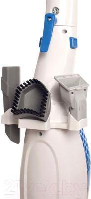 Вертикальный портативный пылесос Kitfort KT-506 - хранение насадок