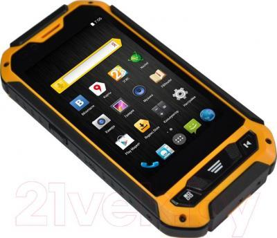 """Смартфон DEXP Ixion P 4"""" (черно-желтый) - вид лежа"""
