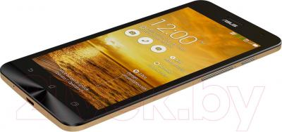 Смартфон Asus ZenFone 5 A501CG (16Gb, золотой) - вид лежа