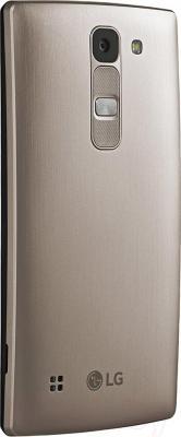 Смартфон LG Y70 Dual Spirit / H422 (черно-золотой) - вид сзади
