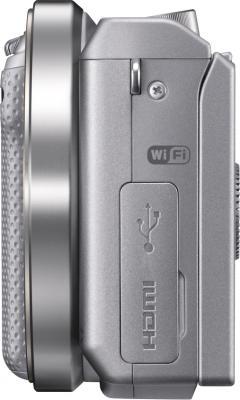 Беззеркальный фотоаппарат Sony Alpha NEX-5RK (серебристый) - вид сбоку