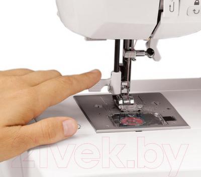 Швейная машина Singer Confidence 7469 - нитевдеватель