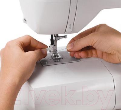 Швейная машина Singer 6160 - нитевдеватель