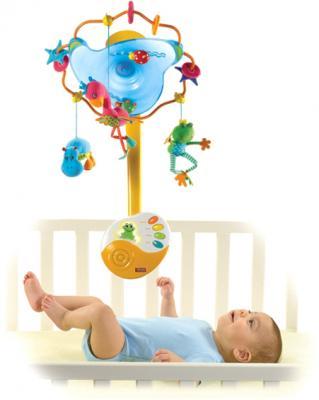Музыкальный мобиль Tiny Love Лесные серенады 1300907578 - ребенок в кроватке