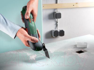 Многофункциональный инструмент Bosch PMF 10.8 LI (0.603.101.925) - в работе