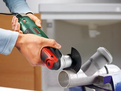 Многофункциональный инструмент Bosch PMF 250 CES (0.603.100.621) - в работе