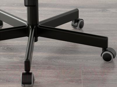 Кресло офисное Ikea Малькольм 201.968.07 (черный) - колесики автоматически блокируются, когда стул не используется