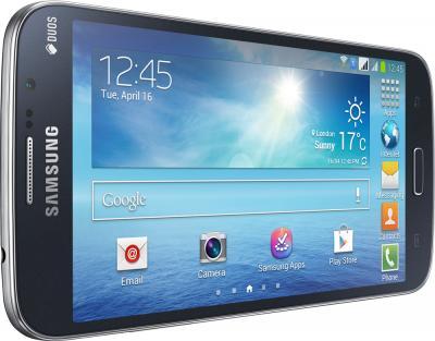 Смартфон Samsung Galaxy Mega 5.8 Duos / I9152 (черный) - вид лежа вполоборота