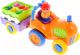 Развивающая игрушка Kiddieland Трактор с овощами 037325 -