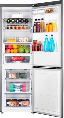 Холодильник с морозильником Samsung RB31FERNCSA/RS - пример заполненного холодильника