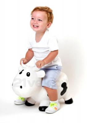 Игрушка-прыгун KidzzFarm Коровка Белла (лиловая с белым) - ребенок на игрушке