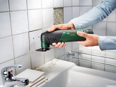 Многофункциональный инструмент Bosch PMF 190 E (0.603.100.502) - в работе