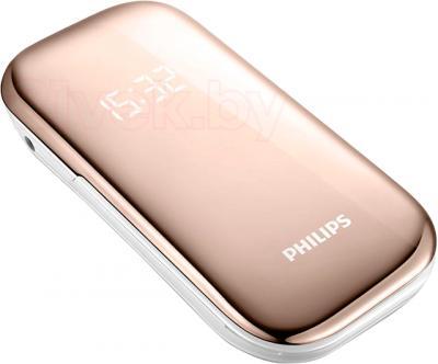 Мобильный телефон Philips E320 - вид лежа