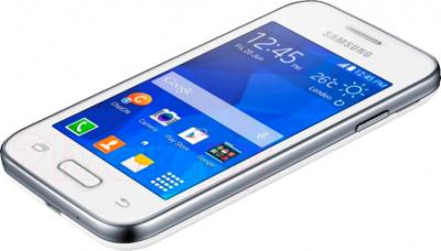Смартфон Samsung G130H (белый) - вид лежа