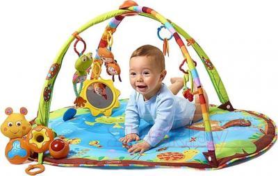 Музыкальный коврик Tiny Love Лесное озеро - ребенок на коврике