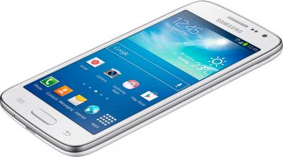 Смартфон Samsung G386F Galaxy Core LTE (White) - вид лежа