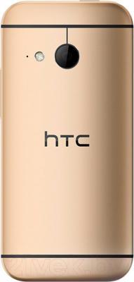 Смартфон HTC One Mini 2 (золотой) - вид сзади