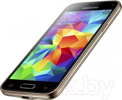 Смартфон Samsung Galaxy S5 mini / G800H (золотой) - вполоборота