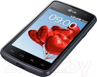 Смартфон LG L50 Dual (D221) (Black) - вид лежа